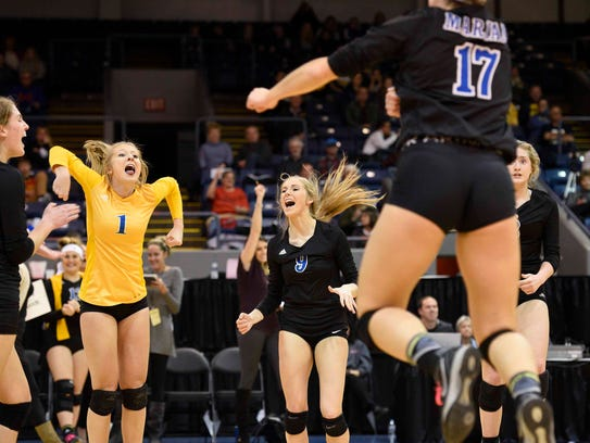 Marian players celebrate after beating Mercy in the Class A state semifinals.