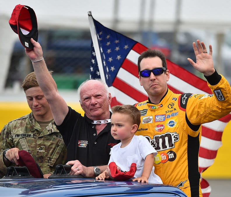 Kyle Busch and his son Brexton prior to the Coca-Cola 600 at Charlotte Motor Speedway. Mandatory Credit: