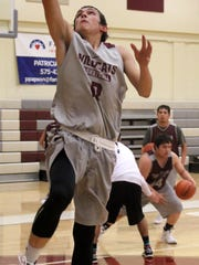 Robert Silva attempts a lay-up during practice Wednesday night. Tularosa begins the season hosting Socorro on Dec. 3.