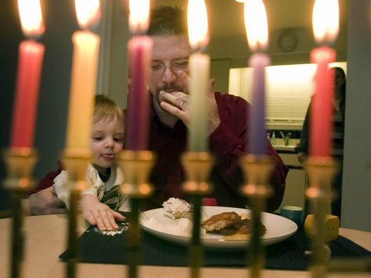 Lighting candles is part of the Hanukkah celebration.
