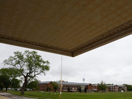 Fort DuPont buildings are shown beyond the overhang of the base theater Tuesday. Delaware City voters on Thursday will vote on annexing the property.