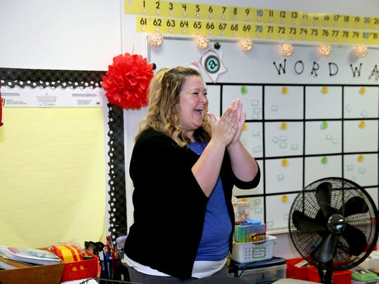"""Esquire Hill Elementary School first grade teacher Amy Coulter reacts as her classroom is chosen to receive gifts from the Inspirus Credit Union. She presented two teachers with """" Fun Friday """" gifts for their classes."""