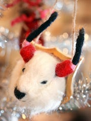 From the Michelle Pemberton collection: A mounted head of a yak head holiday ornament.