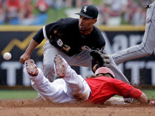 Los Angeles Angels' Collin Cowgill is caught stealing as Chicago White Sox's Micah Johnson makes the play during the third inning, March 13, 2014, in Tempe, Ariz.