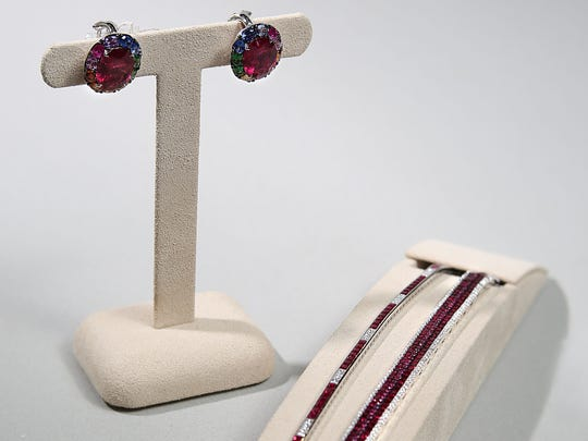 Mixed gem stone on white gold earrings, $9,500. Ruby and diamond on white gold $7,500 along with a ruby and diamond on white gold for $16,500.