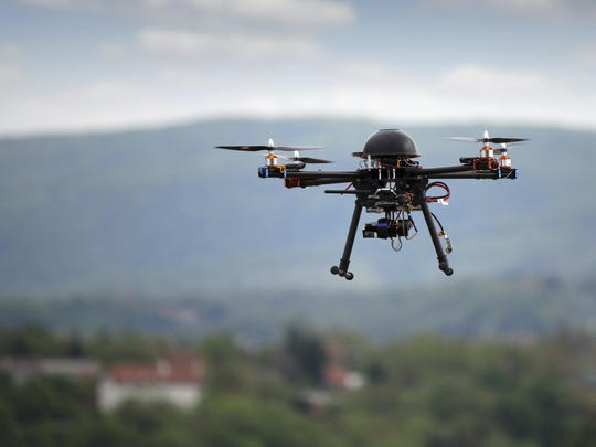 Photo illustration of a drone flying with a camera