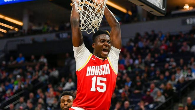 Houston Rockets center Clint Capela yells after dunking the ball against the Minnesota Timberwolves during the second half of an NBA basketball game Friday, Jan. 24, 2020, in Minneapolis.