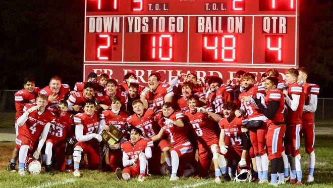 The Hutchinson Trinity football team defeated Hillsboro 41-14 Friday night for the Class 2A District 5 Championship.