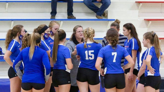 The Pretty Prairie High School volleyball team huddles around head coach Lori Young during a timeout against Cunningham on Sept. 8. Pretty Prairie is 12-0 and ranked No. 2 in Class 1A Division I.