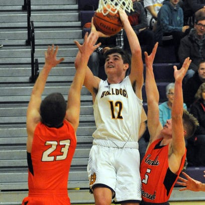 Bloom-Carroll's Ethyn Kuhns takes a shot while guarded