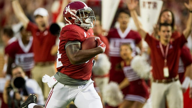 Alabama running back Damien Harris (34) scores a touchdown on the first play from scrimmage against Arkansas in first half action at Bryant Denny Stadium in Tuscaloosa, Ala. on Saturday October 14, 2017.