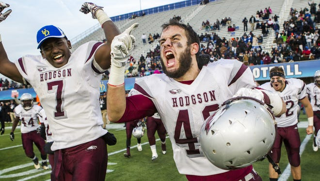 Hodgson's Kyle Taylor (No. 48) and Raymond Jones Jr. (No. 7) celebrate as time expires in the fourth quarter of the DIAA Division II State Championship football game at Delaware Stadium in Newark on Saturday afternoon. Hodgson defeated Laurel by a score of 42-0.