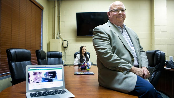 Mark Landis, founder and president of Metro Merchant Services, will move his business from Delaware City to Prices Corner on Monday. His daughter Kelly (center) is the company's social media marketing manager.