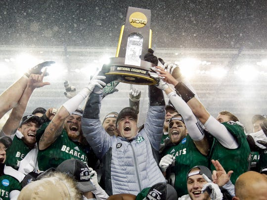 Northwest Missouri State head coach Adam Dorrel, center, holds up the championship trophy after an NCAA Division II championship football game against North Alabama, Saturday, Dec. 17, 2016, in Kansas City, Kan. Northwest Missouri State won 29-3.