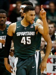 In this Dec. 19, 2015, file photo, Michigan State's Denzel Valentine reacts after sinking a basket against Northeastern during the second half of a NCAA college basketball game in Boston.