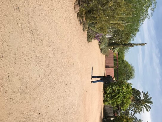 An FBI employee walks outside the Paradise Valley home