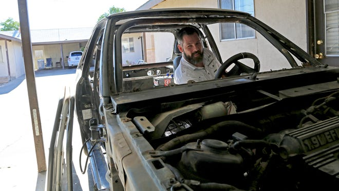 St. George resident Travis Olsen is fixing up one of his many Ford Escorts to participate in the demolition derby figure 8 race at the Washington County Fair on Aug. 12.
