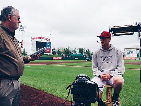 News-Leader sports reporter Lyndal Scranton interviewing