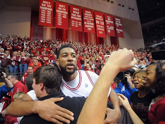 Christian Watford, who hit the game winning shot is swarmed by fans after the game. IU hosted Kentucky in men's basketball at Assembly Hall in December, 10, 2011.