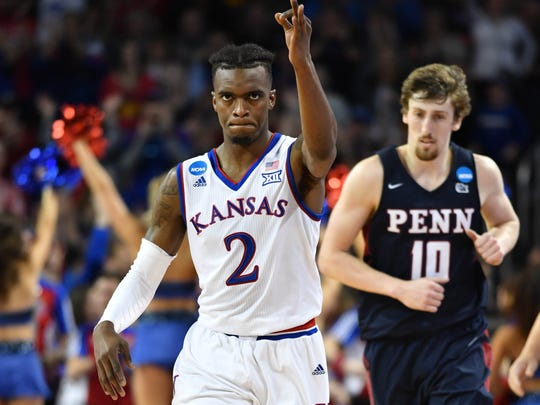 Kansas Jayhawks guard Lagerald Vick (2) celebrates after a three-point basket against the Pennsylvania Quakers during the second half in the first round of the 2018 NCAA Tournament at INTRUST Bank Arena.