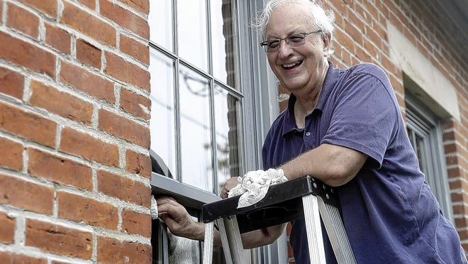 Steve Jackson, Southwest Franklin County Historical Society president, shares a laugh with historical society members as he cleans the Orders School House's windows July 22 at Century Village in Grove City. The Grove City Rotary is honoring Jackson with its 2020 Service Above Self Award.