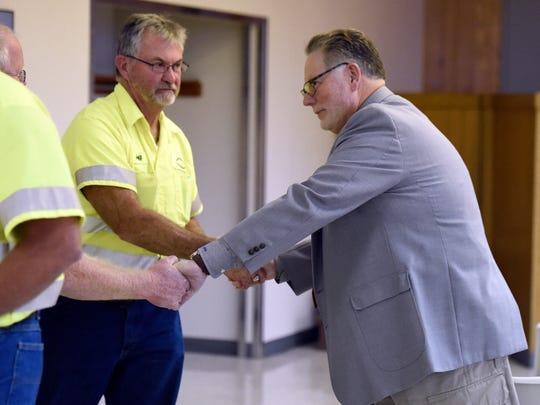 Vanderburgh County Commissioner candidate Steve Melcher shakes hands with Jeff Baggett, center, and Jeff Mitchell while visiting with workers at the Teamsters Local 215 headquarters in Evansville recently.