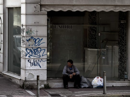 A picture taken May 9, 2017, shows a homeless man sitting
