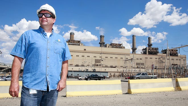 Tom Fallgren, plant manager at the San Juan Generating Station, on Aug. 1 stands in the area in Waterflow where a new natural gas-fired peaking plant is expected to be built. The San Juan Generating Station can be seen in the background.