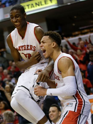 Jaren Jackson Jr., left, celebrates during the Class 2A Indiana state boys basketball championship game March 28, 2015, in Indianapolis.