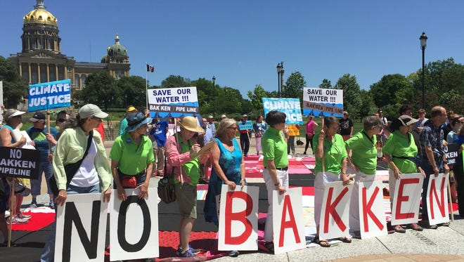 Iowans opposed to the Bakken oil pipeline rallied at the Iowa Capitol in June 2016 after the Iowa Utilities Board gave a go-ahead for construction to start along most of the Iowa route.