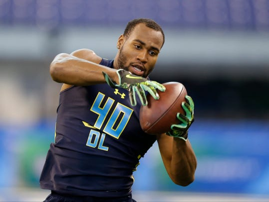 In this Sunday, March 5, 2017, photo, Temple defensive end Haason Reddick runs a drill at the NFL football scouting combine in Indianapolis. Reddick is enjoying the draft process even as other potential pros get antsy for the big day to arrive. Maybe it's because he went to school in Philadelphia, at Temple, and the draft will be in Philly. (AP Photo/Michael Conroy)