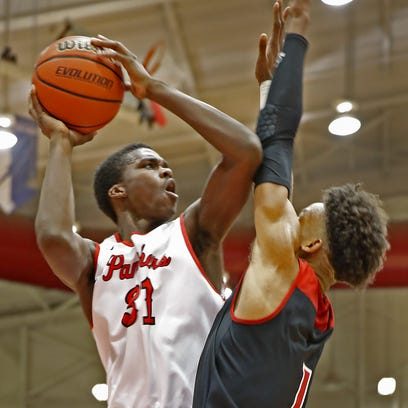 North Central's Kris Wilkes (31) shoots over New Albany's