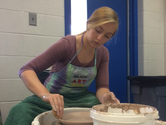 Madi Kimmel works on a plate during pottery class at Fort Defiance High School, Sept. 6, 2016.