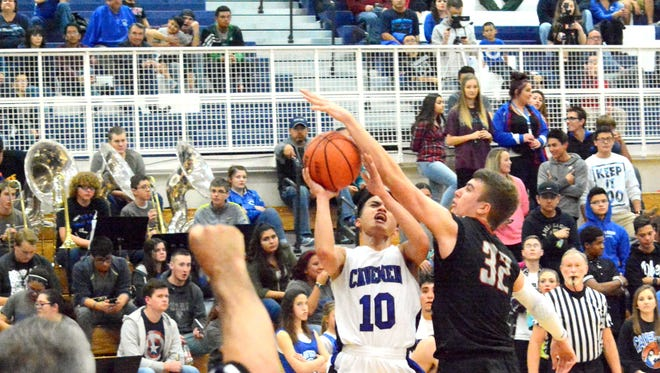 Carlsbad senior point guard Ralph Cueto is fouled by Artesia senior forward Justin Houghtaling on his way to the basket in the fourth quarter Friday.