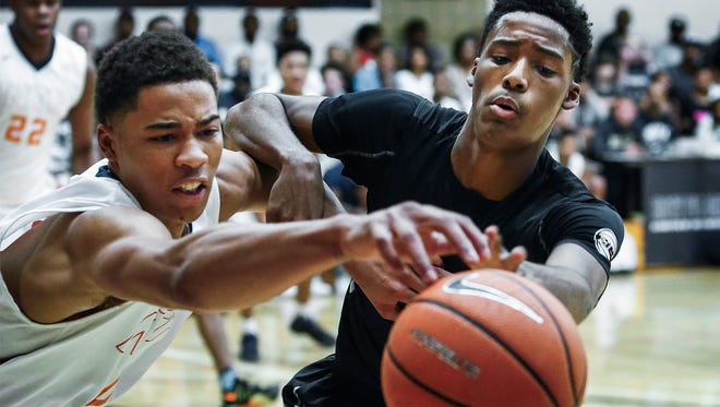 Team Penny guard Jayden Hardaway (right) battles Nike Team Florida guard KJ Buffen (left) for a loose ball during action at the 2017 Nike Peach Jam in North Augusta, S.C.