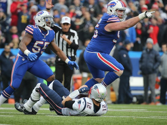 Bills Kyle Williams celebrates his sack of Tom Brady.