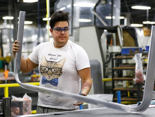 Tristan Ribera, 20, of Wausau, works on an aluminum