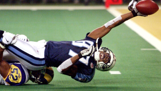 Titans receiver Kevin Dyson tries in vain to stretch across the goal line on the  final play of Super Bowl XXXIV.