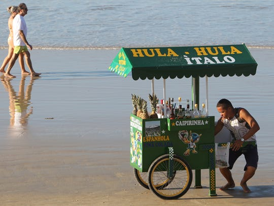 Natal.  5/25/14  Pina Coladas sold on the beach by Hula-Hula Italo on Ponta Negra Beach in Natal, Brazil.  (Carlos Chavez/The Arizona Republic) #soccerislife #worldcup2014