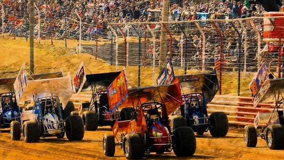 A field of 410 Sprint cars cruises past the grandstand at Selinsgrove Speedway. The track will host a variety of divisions in 2016.