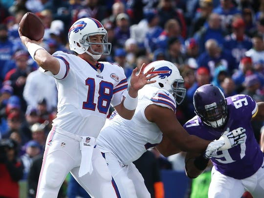 Kyle Orton #18 of the Buffalo Bills throws against the Minnesota Vikings during the first half at Ralph Wilson Stadium on October 19, 2014.