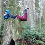 Lydia Thomas relaxes at Crator Lake National Park in between work adventures through Workaway .info.