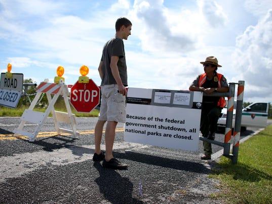 Mirta Maltes a U.S. Park Ranger law enforcement officer speaks with Christoph Zuercher, a tourist from Switzerland