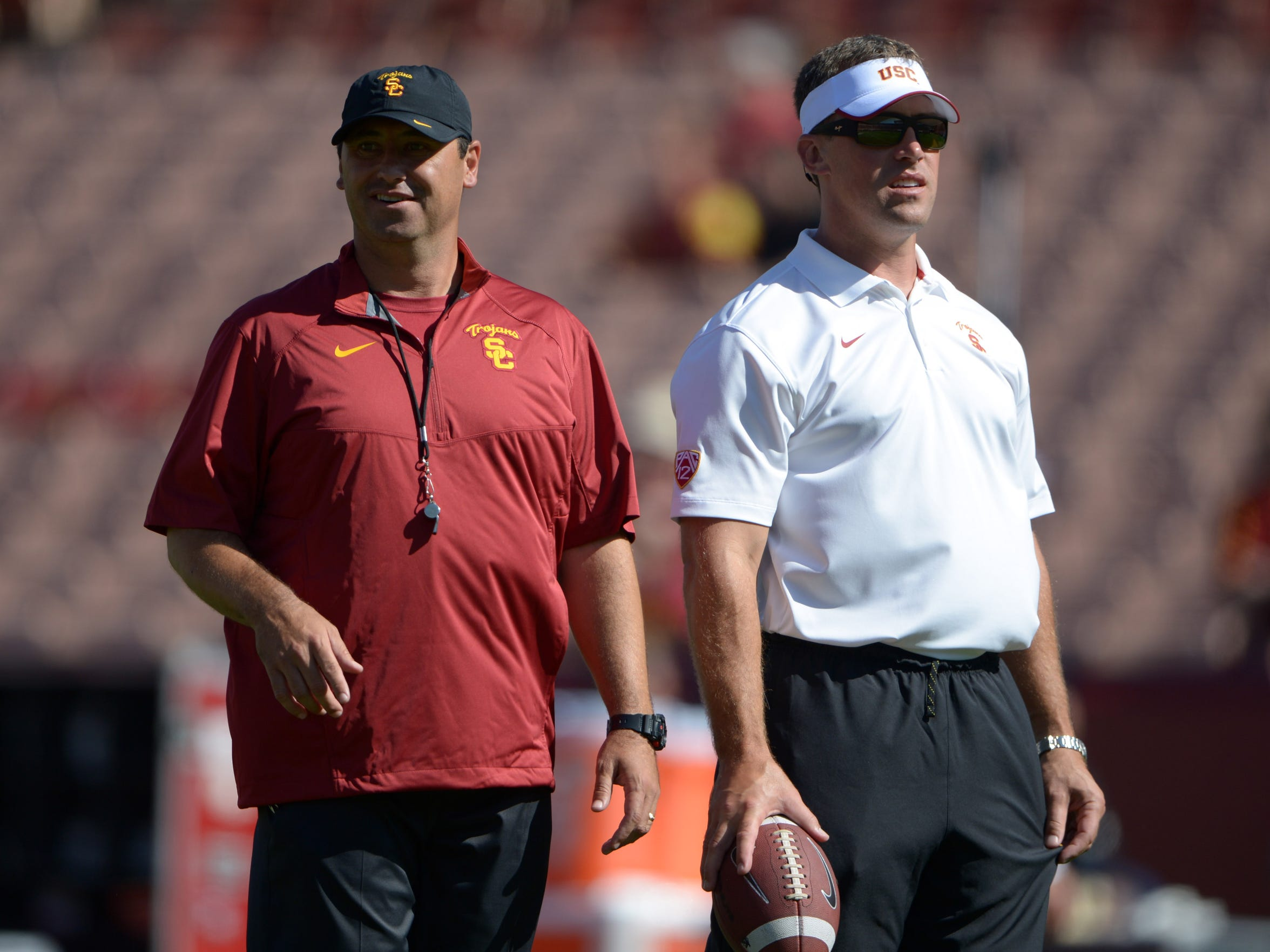 USC head coach Steve Sarkisian, left, hired Peter Sirmon as his linebackers coach. Sirmon eventually coached the defense during the team's 2015 bowl game after Sarkisian's firing.