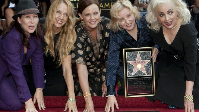 The Go-Go's, from left, Kathy Valentine, Charlotte Caffey, Belinda Carlisle, Gina Schock and Jane Wiedlin  are honored with a star on the Hollywood Walk of Fame on Aug. 11, 2011, in Los Angeles. The band is the subject of a new documentary available on Showtime.