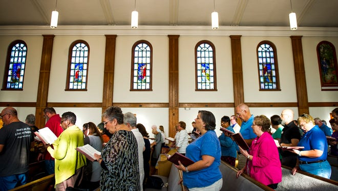 Attendees from area churches sing and pray together during a prayer service for peace held at Second United Methodist Church on Friday, August 25, 2017, in response to a planned white supremacist rally and its counter protest in Knoxville.