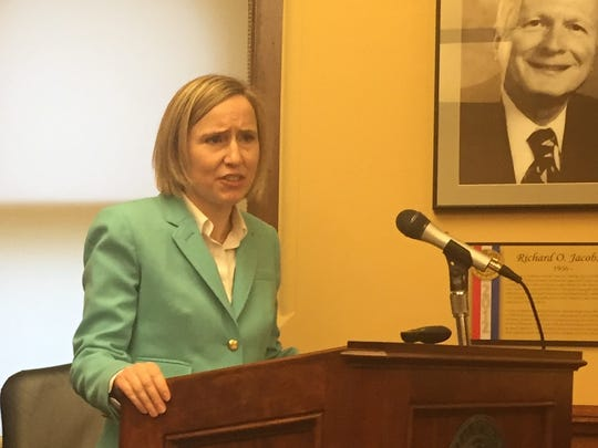 Megan Took, executive director of the Iowa Ethics and Campaign Disclosure Board, addresses Gov. Terry Branstad's budget hearing Tuesday at the Iowa Capitol.