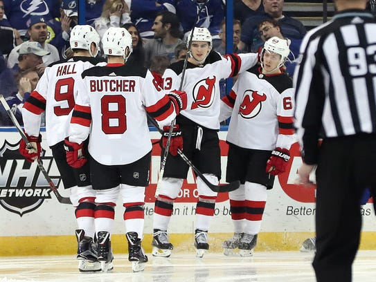 New Jersey Devils center Nico Hischier (13) is congratulated