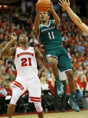 Anthony Brown goes in for a shot in the first half of UWGB's loss to Wisconsin last season.