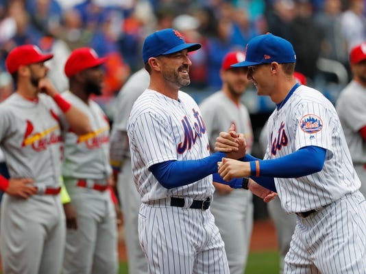 New York Mets center fielder Brandon Nimmo, right, greets New York Mets manager Mickey Callaway during pregame introductions before an opening day baseball game, Thursday, March 29, 2018, in New York. (AP Photo/Kathy Willens)